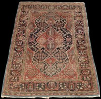 Lot 818 - A Kinuan rug, the shaped field with floral...