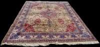 Lot 820 - A Tabriz carpet, the central floral medallion...