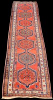 Lot 821 - A Sarab runner, with six medallions on a red...