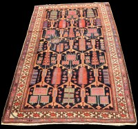 Lot 823 - A Bakhtiari rug, with geometric floral panels...