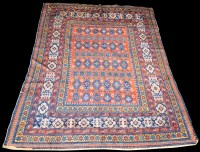 Lot 824 - A Caucasian rug, the repeated floral design on...