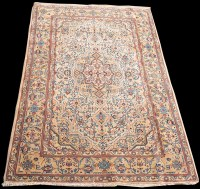 Lot 827 - A Kashan rug, the ivory ground with full...