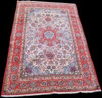 Lot 828 - A Isfahan rug, the red circular medallion...