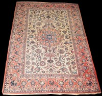 Lot 830 - An Isfahan rug, the central red medallion...