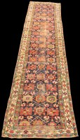 Lot 835 - A Caucasian runner, with bold geometric floral...
