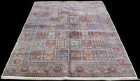 Lot 837 - A Tabriz carpet, with panels of floral designs,...