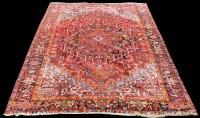Lot 838 - A Heriz carpet, with bold geometric floral...