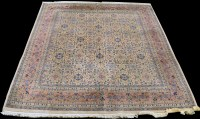 Lot 839 - A Tabriz carpet, the ivory ground with full...