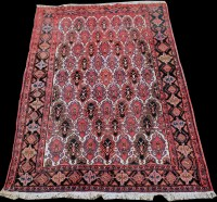 Lot 844 - An Afshar rug, with scrolling panels and...