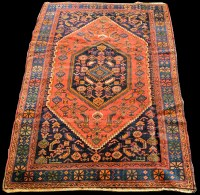 Lot 850 - A Malaya rug, the central medallion and ground...