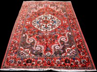 Lot 854 - A Bakhtiari carpet, with full floral...