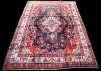 Lot 857 - A Kashan carpet, the floral medallion on blue...