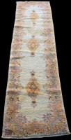Lot 858 - A Kirman runner, with three floral medallions...