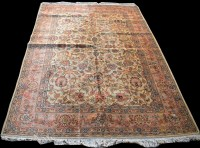Lot 859 - A Tabriz carpet, with floral scrolling design...
