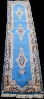 Lot 860 - A Kirman runner, three floral designs on blue...