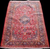 Lot 861 - A Kashan rug, with scrolling floral design...