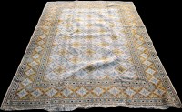 Lot 864 - A Kashan carpet, with diamond-shaped floral...
