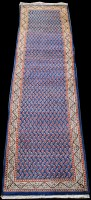 Lot 865 - A Sarough runner, with boteh design on blue...