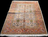 Lot 866 - A Tabriz carpet, with floral panels on ivory...