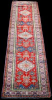 Lot 869 - An Afghan runner, with three diamond-shaped...