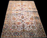 Lot 870 - A Tabriz carpet, the bold floral scrolls on...