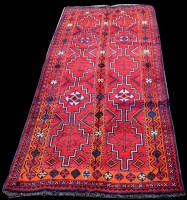 Lot 872 - A Shiraz rug, with geometric design on red...