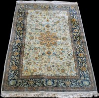 Lot 873 - An Indian rug, with floral design on ivory...