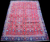 Lot 874 - A Najafabad rug, with foliate scrolls on red...