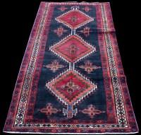 Lot 876 - A Hamadan Luri rug, with triple medallion...