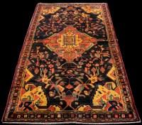 Lot 877 - A Hamadan Luri rug, with geometric floral...