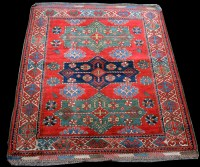 Lot 878 - A Caucasian style rug, with three medallions...