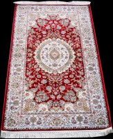 Lot 879 - A woven silk rug, with central circular floral...