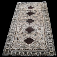 Lot 880 - A Qashqai rug, the brown field with five...