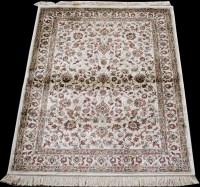 Lot 883 - A Kashmir rug, with scrolling floral design on...