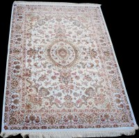 Lot 885 - A woven silk rug, with central floral...