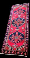 Lot 887 - A Persian runner, with diamond-shaped...