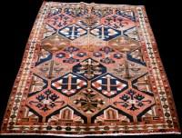 Lot 891 - A Bakhtiari rug, with diamond-shaped panels...