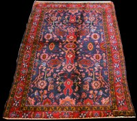 Lot 895 - A Mashad rug, with floral design on blue...
