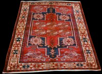 Lot 896 - A Shiraz rug, with geometric design on red...