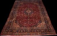 Lot 897 - A Kashan carpet, with central floral medallion...