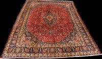Lot 898 - A Mashad carpet, the central medallion on red...