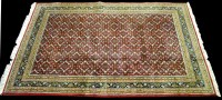 Lot 899 - A Bidjar carpet, the red ground with small...