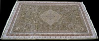 Lot 901 - A Persian woven silk carpet, with green ground...