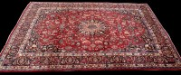 Lot 902 - A Mashad carpet, the red ground with central...