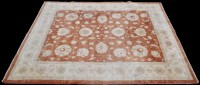 Lot 903 - An Afghan Ziegler carpet, the terracotta field...