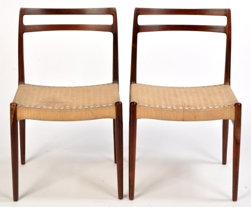 Lot 7-A set of eight rosewood dining chairs attributed...