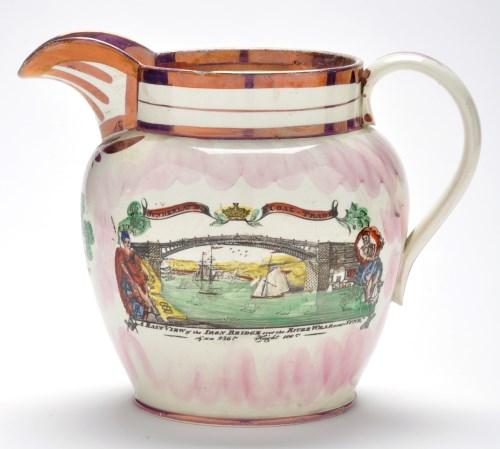 Lot 368-Lustreware coloured printed creamware jug of...
