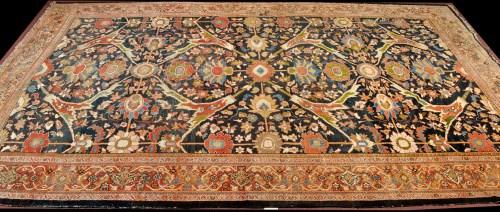 Lot 1251 - A large antique Ushak carpet, the blue field...
