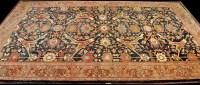 Lot 1251-A large antique Ushak carpet, the blue field...
