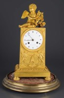 Lot 1282-A French gilt bronze mantel clock, the...